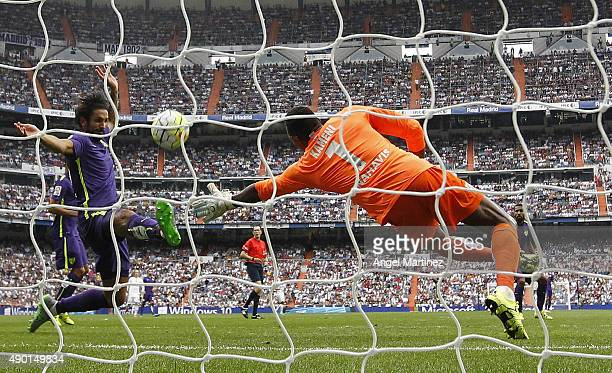 Carlos Kameni of Malaga saves the ball during the La Liga match between Real Madrid CF and Malaga CF at Estadio Santiago Bernabeu on September 26...