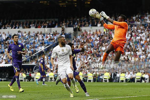 Carlos Kameni of Malaga saves the ball in front of Karim Benzema of Real Madrid during the La Liga match between Real Madrid CF and Malaga CF at...