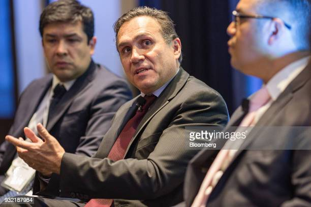 Carlos Kretschmer director general of Quanta Shares center speaks as Ociel Hernandez analyst at BBVA Bancomer SA left and Juan Francisco Caudillo...