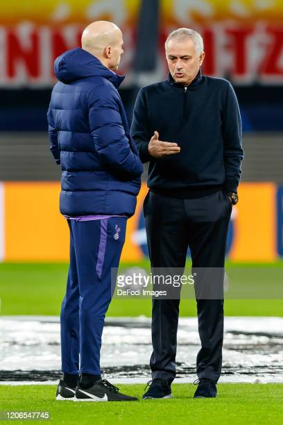 Carlos Lalin of Tottenham Hotspur and head coach Jose Mourinho of Tottenham Hotspur to discuss prior to the UEFA Champions League round of 16 second...