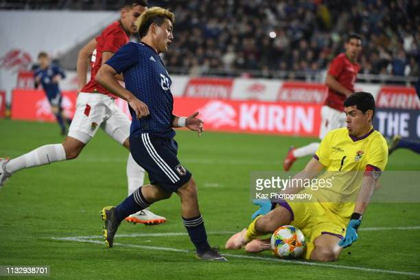 Carlos Lampe of Bolivia blocks the shoot of Ritsu Doan of Japan during the international friendly match between Japan and Bolivia at Noevir Stadium...