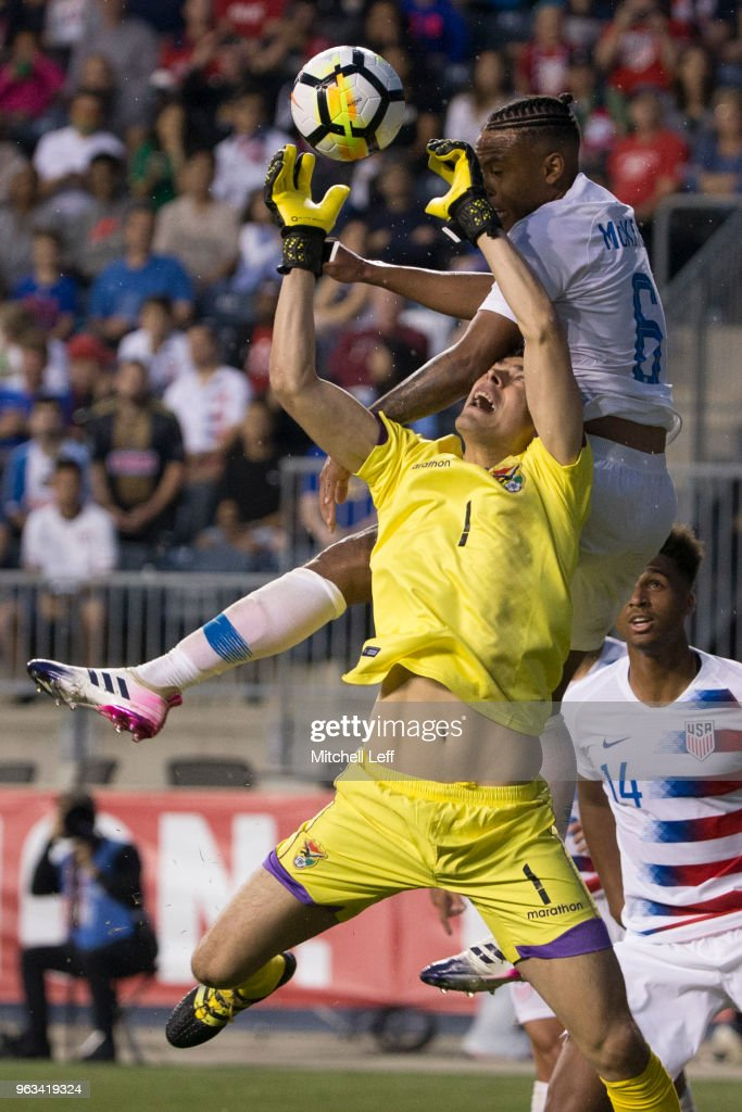 Carlos Lampe #1 of Bolivia makes a save against Weston McKennie #6 of the United States in the second half of the friendly soccer match at Talen Energy Stadium on May 28, 2018 in Chester, Pennsylvania. The United States defeated Bolivia 3-0.