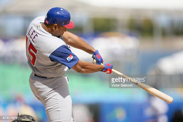 Carlos Lee of Panama bats during the game against the Netherlands at Hiram Bithorn Stadium on March 10, 2006 in San Juan, Puerto Rico. The...
