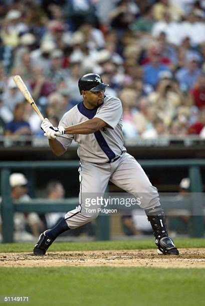 Carlos Lee of the Chicago White Sox swings during the game against the Detroit Tigers on July 31 2004 in Detroit Michigan The Tigers won the game 32...