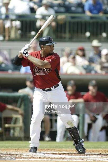Carlos Lee of the Houston Astros bats against the Washington Nationals during a Spring Training game on March 7 2007 at Osceola County Stadium in...