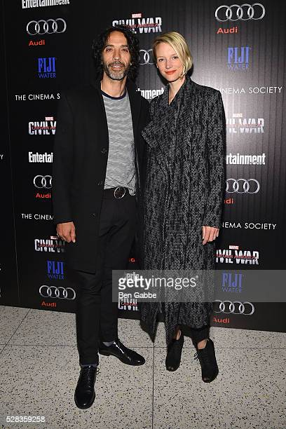 Carlos Leon and Betina Holte attend a screening of Marvel's 'Captain America Civil War' hosted by The Cinema Society with Audi FIJI on May 04 2016 in...