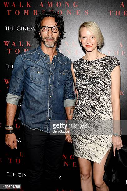 Carlos Leon and Betina Holte attend the Universal Pictures and Cross Creek Pictures with The Cinema Society screening of A Walk Among the Tombstones...