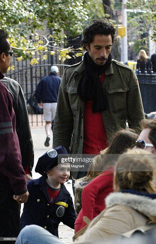 Carlos Leon (rear) walks with his daughter with Madonna, Lourdes, and Madonna's son Rocco on October 23, 2005 in New York City.