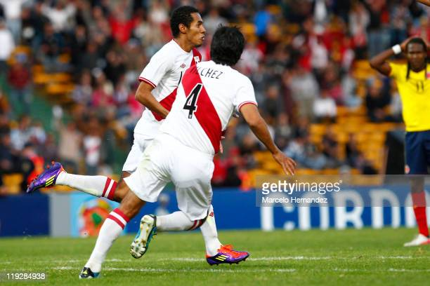 Carlos Lobaton of Peru celebrates his scored goal against Colombia during a quarter final match between Colombia and Peru at Mario Alberto Kempes...