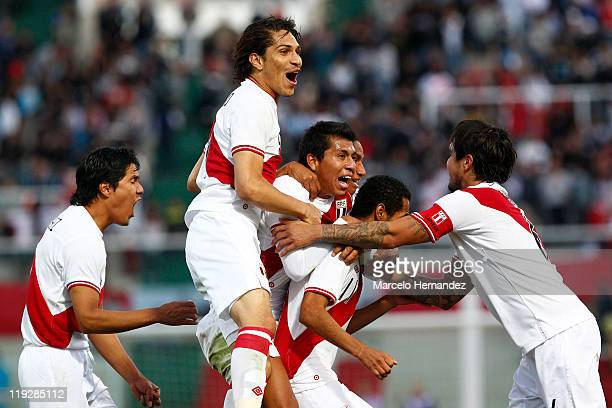 Carlos Lobaton of Peru celebrates with teammates his scored goal against Colombia during a quarter final match between Colombia and Peru at Mario...