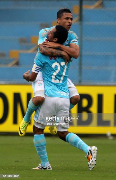 Carlos Lobaton of Sporting Cristal celebrates with his team mate a scored goal against Inti Gas during a match between Sporting Cristal and Inti Gas...