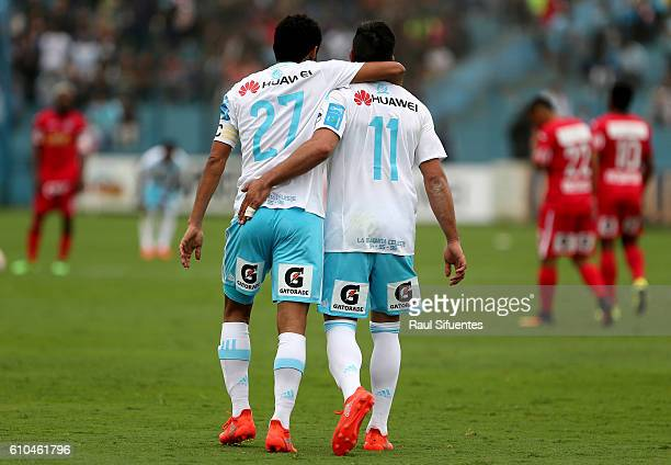 Carlos Lobaton of Sporting Cristal celebrates with teammate Diego Ifran after scoring the first goal of his team against Juan Aurich during a match...