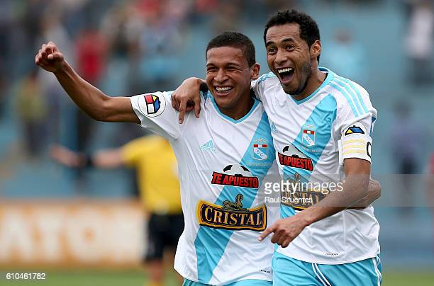 Carlos Lobaton of Sporting Cristal celebrates with teammate Fernando Pacheco after scoring the first goal of his team against Juan Aurich during a...