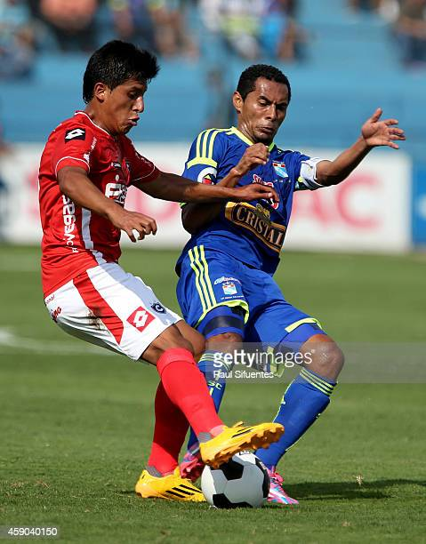 Carlos Lobaton of Sporting Cristal struggles for the ball with Herbert Castillo of Cienciano during a match between Sporting Cristal and Cienciano as...