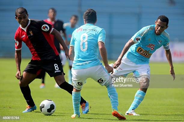 Carlos Lobaton of Sporting Cristal struggles for the ball with Nelinho Quina of FBC Melgar during a match between Sporting Cristal and FBC Melgar as...