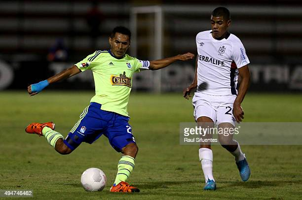 Carlos Lobaton of Sporting Cristal struggles for the ball with Wilder Cartagena of San Martin during a match between San Martin and Sporting Cristal...