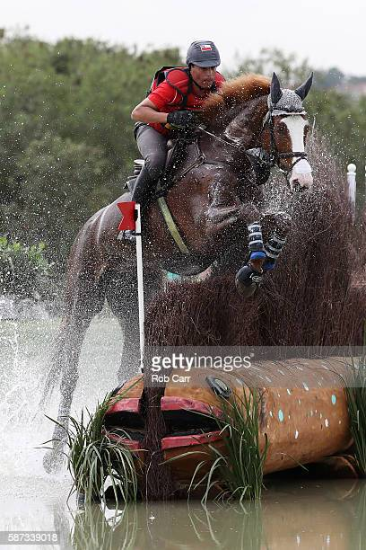 Carlos Lobos Munoz of Chile riding Ranco clears a jump during the Cross Country Eventing on Day 3 of the Rio 2016 Olympic Games at the Olympic...