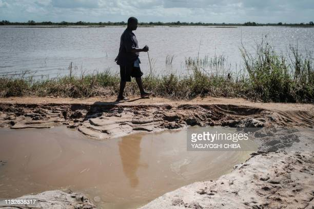 Carlos Lomos is walking for 2 days from Buzi without any food to eat to meet his family on a street destroyed by the Cyclone Idai in Tica Mozambique...