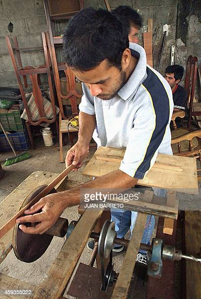 Carlos Lopez works at one of the carpentery centers created by the Bolivian Circle in Barquisimeto City located 250 km southwest of Caracas 24 April...