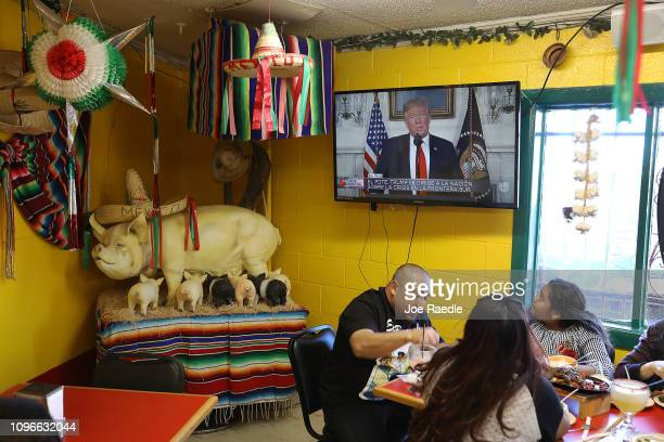 Carlos Luna his daughter Dareyna Luna and family dine at El Toro Bronco restaurant as US President Donald Trump delivers a televised speech on...