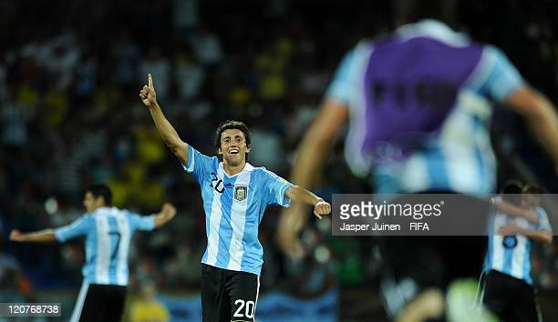 Carlos Luque of Argentina celebrates with his teammates at the end of the FIFA U20 World Cup Colombia 2011 round of 16 match between Argentina and...