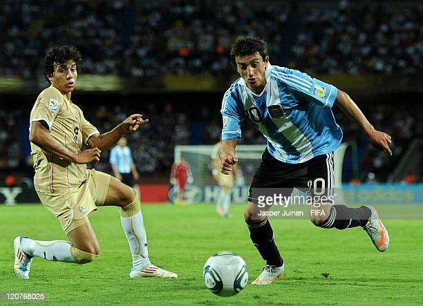 Carlos Luque of Argentina duels for the ball with Ahmed Sohby of Egypt during the FIFA U20 World Cup Colombia 2011 round of 16 match between...