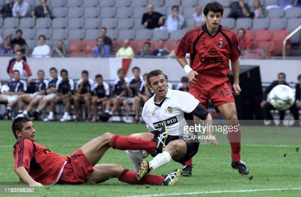 Carlos Machena of Valencia tussles for the ball with Francesco Coco of AC Milan on Saturday 28 July 2001 during the Amsterdam Soccer Tournament in...