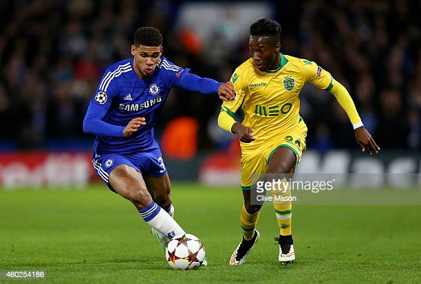 Carlos Mane of Sporting Lisbon is challenged by Ruben LoftusCheek of Chelsea during the UEFA Champions League group G match between Chelsea and...