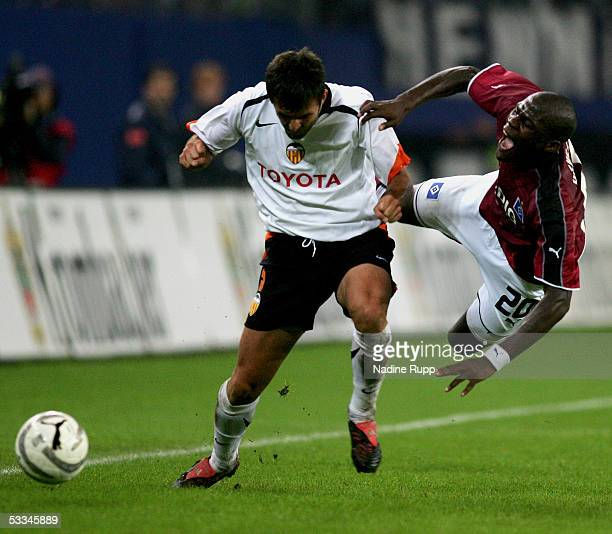 Carlos Marcuena Lopez of Valencia competes with Guy Demel of HSV during the Intertoto Cup Final between Hamburger SV and FC Valencia at the AOL Arena...