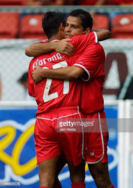 Carlos Maria Morales celebrates with Enrique Alfaro during a match between Toluca and Santos on September 8, 2001 in Toluca, Mexico.