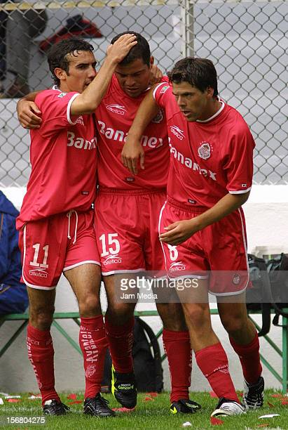Carlos Maria Morales celebrates with Rafael Garcia and Vicente Sanchez during a match between Toluca and Morelia on September 22, 2001 in Toluca,...