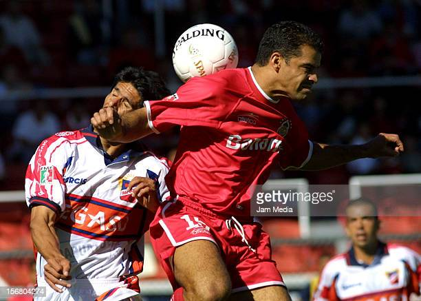 Carlos Maria Morales fights for the ball with Ramiro Briseno during a match between Toluca and Irapuato as part of the Winter Tournament on October...