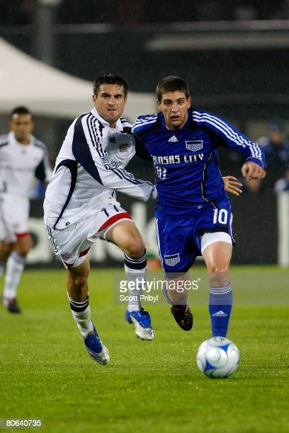 Carlos Marinelli of the Kansas City Wizards dribbles against Gary Flood of the New England Revolution during the game at Community America Ballpark...