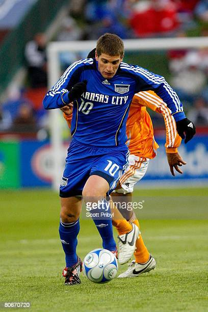 Carlos Marinelli of theKansas City Wizards dribbles against the Houston Dynamo during the game at Community America Ballpark on April 12 2008 in...