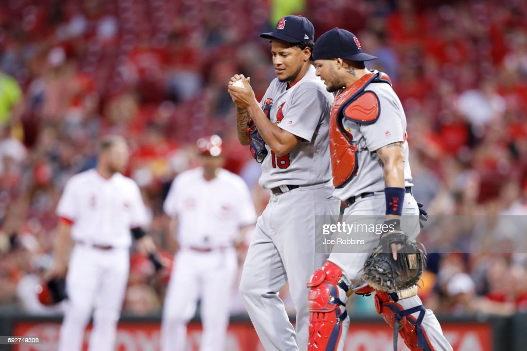 Carlos Martinez #18 and Yadier Molina #4 of the St. Louis Cardinals meet at the mound after allowing two hits to begin the seventh inning of a game against the Cincinnati Reds at Great American Ball Park on June 5, 2017 in Cincinnati, Ohio. The Reds defeated the Cardinals 4-2.
