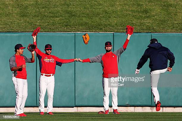 Carlos Martinez Jaime Garcia and Edward Mujica of the St Louis Cardinals pose as a field goal post in the outfield before Game Three of the 2013...