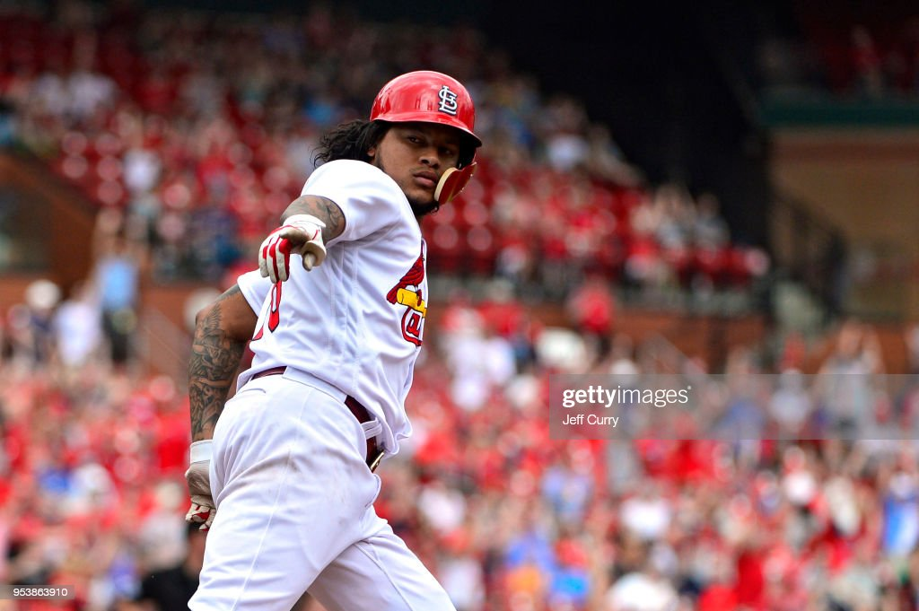 Carlos Martinez #18 of the St. Louis Cardinals celebrates after hitting a solo home run during the sixth inning against the Chicago White Sox at Busch Stadium on May 2, 2018 in St Louis, Missouri.