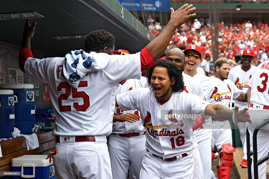 Carlos Martinez #18 of the St. Louis Cardinals celebrates with Dexter Fowler #25 after hitting a solo home run during the sixth inning against the Chicago White Sox at Busch Stadium on May 2, 2018 in St Louis, Missouri.