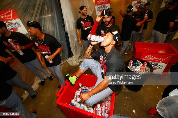Carlos Martinez of the St Louis Cardinals celebrates with teammates in the clubhouse following their division clinching 111 win against the...