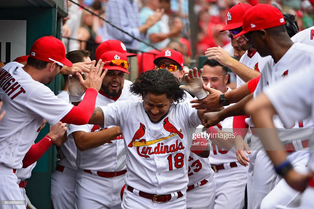 Carlos Martinez #18 of the St. Louis Cardinals celebrates with teammates after hitting a solo home run during the sixth inning against the Chicago White Sox at Busch Stadium on May 2, 2018 in St Louis, Missouri.