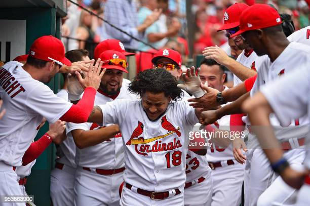 Carlos Martinez of the St Louis Cardinals celebrates with teammates after hitting a solo home run during the sixth inning against the Chicago White...