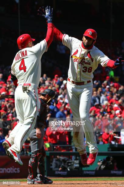 Carlos Martinez of the St Louis Cardinals celebrates with Yadier Molina of the St Louis Cardinals after hitting a threerun home run against the...
