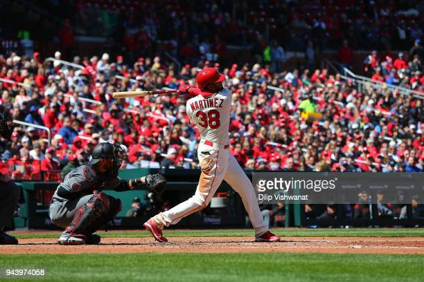 Carlos Martinez of the St Louis Cardinals hits a home run against the Arizona Diamondbacks at Busch Stadium on April 7 2018 in St Louis Missouri...