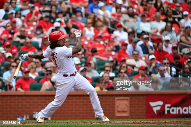 Carlos Martinez of the St Louis Cardinals hits a solo home run during the sixth inning against the Chicago White Sox at Busch Stadium on May 2 2018...