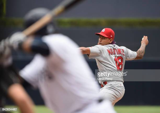 Carlos Martinez of the St Louis Cardinals pitches to Carlos Asuaje of the San Diego Padres during the first inning of a baseball game at PETCO Park...
