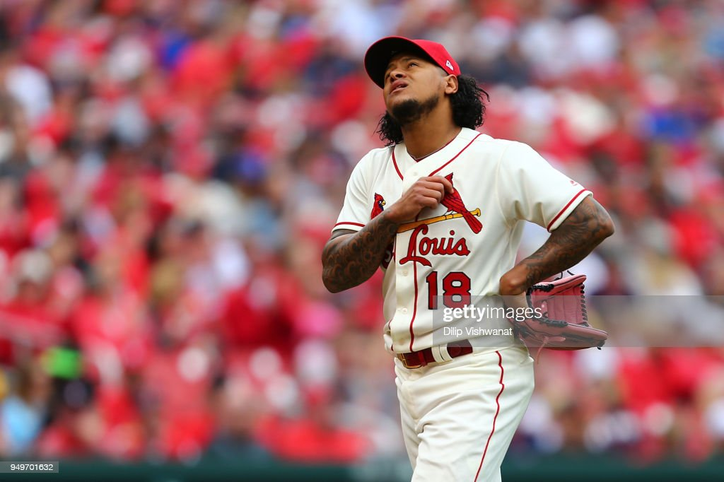 Carlos Martinez #18 of the St. Louis Cardinals returns to the dugout after recording the final out of the fifth inning against the Cincinnati Reds at Busch Stadium on April 21, 2018 in St. Louis, Missouri.