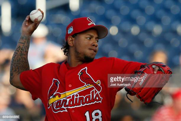Carlos Martinez of the St Louis Cardinals throws the ball against the Houston Astros in the second inning during a spring training game at The...