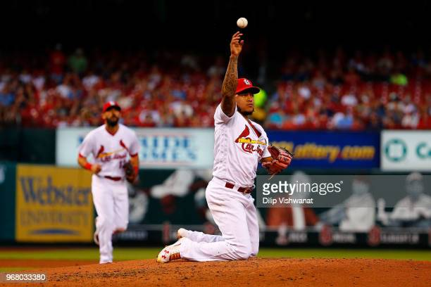 Carlos Martinez of the St Louis Cardinals throws to first base against the Miami Marlins in the third inning at Busch Stadium on JUNE 5 2018 in St...