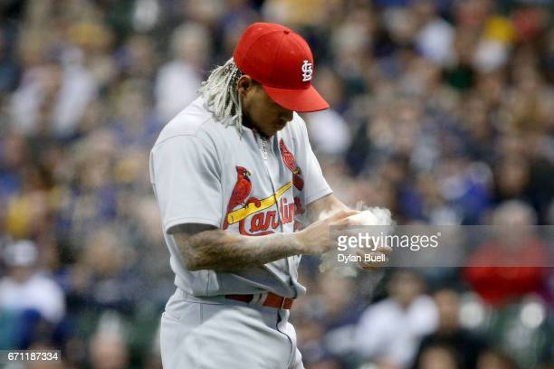 Carlos Martinez of the St Louis Cardinals uses a rosin bag in the first inning against the Milwaukee Brewers at Miller Park on April 20 2017 in...