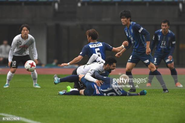 Carlos Martinez of Tokyo Verdy is challenged during the JLeague J1 Promotion PlayOff semi final match between Avispa Fukuoka and Tokyo Verdy at Egao...